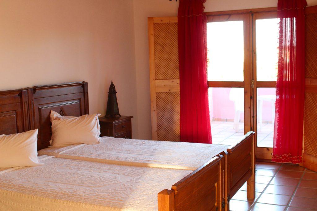 Chambre double avec deux lits simples